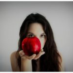 Woman-holding-apple