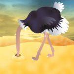 Cartoon Of ostrich sticking head in the sand
