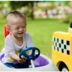 Young Child Driving A Toy