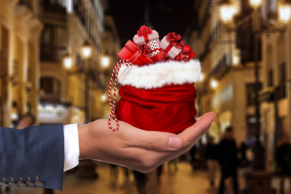 Image of hand with Christmas gifts