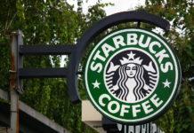 Caption: Photo of Starbucks coffee store sign