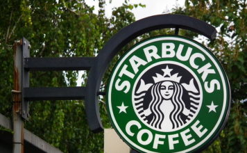 Caption: Photo of Starbucks coffee store sign