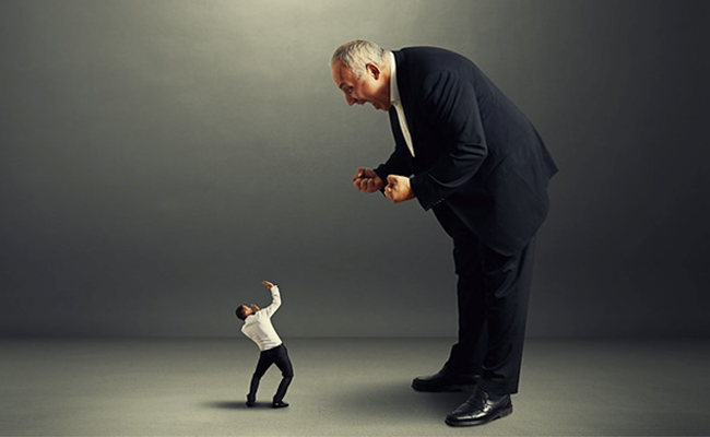 Man yelling at another man for failure in implementing decisions